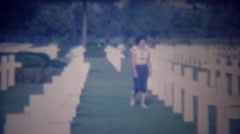 1963: Woman visits Italian American memorial white cross cemetery. Stock Footage