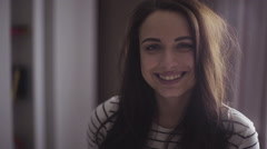 Footage of a model who is smiling on camera, girl is posing for a picture - stock footage