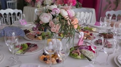 Festive table with flowers and glasses Stock Footage