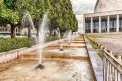 Scenic fountain, neoclassical architecture in the EUR district, Rome, Italy - stock photo