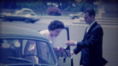 1963: Italian chauffeur opens car door lady amazed tourist. Stock Footage