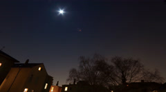 Nightsky stars and moon timelapse city backstreet - stock footage