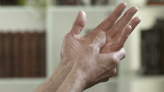 Man with arthritis pain in his hands - stock footage
