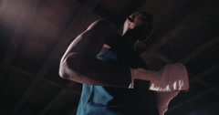 Silhouette shot of african-american boxer wrapping his hands - stock footage