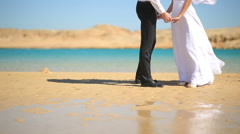 Wedding couple hugs on the beach. Sea background. Half-length Stock Footage