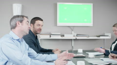 Group of business people have discussion at the meetingroom in front of a gre Stock Footage