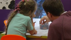 Kid and Father Are Drawing With Pencils Dad Chooses a Pencils and Drawing Stock Footage