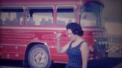 1963: Italian woman grandma wait red tour bus travel sightseeing. Stock Footage
