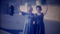 1963: Italian lady grandma love holding hands wave happy smiles. Stock Footage