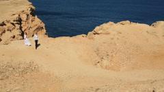 Happy young wedding couple walks in the desert. Honeymoon in Egypt Stock Footage