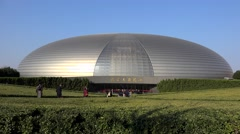 Visitors go to the National Centre for the Performing Arts. Beijing, China Stock Footage