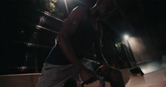 Fit african-american lifting kettle bell for weight training - stock footage