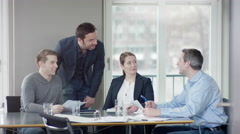 Group of businesspeople have discussion in a meetingroom and looking afterwar Stock Footage