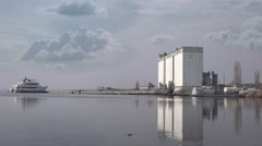 Building grain storage, ELEVATOR riverside reflected in water, agriculture Stock Footage