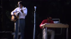1961: Local music festival band playing on stage people dancing. Stock Footage