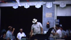 1961: Rural country public auction outdoor sale lamp antiques. Stock Footage