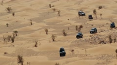 Driving off-road car in the sahara desert Stock Footage