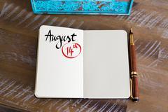 August 14 Calendar Day handwritten on notebook - stock photo