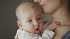 Cute Portrait of Beautiful Attractive Mother and Baby Stock Footage