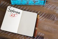 September 25 Calendar Day handwritten on notebook - stock photo