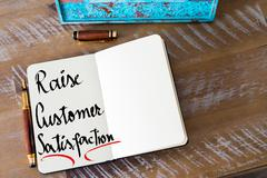 Written text Raise Customer Satisfaction - stock photo