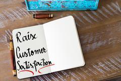 Written text Raise Customer Satisfaction Stock Photos
