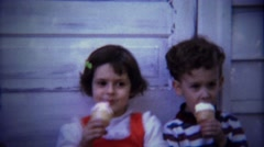 1974: Cure kids eating messy melting ice cream cones. Stock Footage