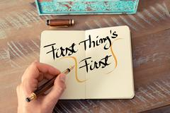 Written text First Thing's First - stock photo
