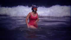 1974: Women survives big ocean waves points like told you so. Stock Footage