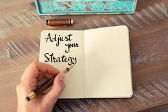 Written text Adjust Your Strategy - stock photo