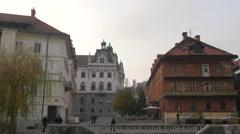 People walking on a street close to the University of Ljubljana in Ljubljana Stock Footage
