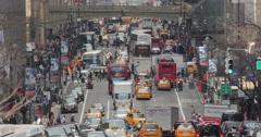 Street car traffic and crowd of people walking crossing street in Manhattan Stock Footage