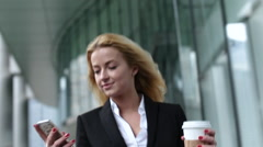 Beautiful Mixed Race Business Woman Walking Through City Connected Using Smart - stock footage