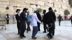 Singing  and dancing jewish men in Western Wall - Jerusalem Stock Footage