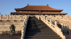 Tourist on the marble staircase to the Hall of Supreme Harmony of Forbidden City - stock footage