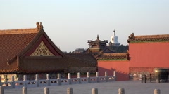 White Pagoda of Beihai Park from the Hall of Central Harmony (Forbidden City). - stock footage