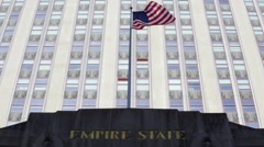 Empire State Building USA Flagpole in Manhattan New York Stock Video Stock Footage