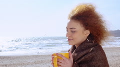 Beautiful pensive redhead woman at the beach watching the sea Stock Footage