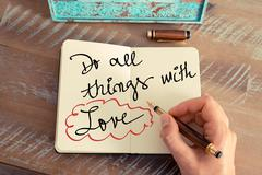Handwritten text DO ALL THINGS WITH LOVE - stock photo
