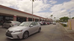 Shopping center with moving cars and traffic Stock Footage