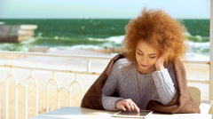 Stock Video Footage of Beautiful pensive redhead woman at the beach