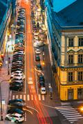 Night Traffic and parked cars on the Hybernska street in Prague - stock photo