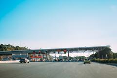 Cars passing through the point of toll highway, toll station nea Stock Photos