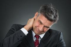 Photo Of Mature Businessman Suffering From Neck Pain Kuvituskuvat