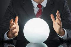 Close-up Of Businessman Hand On Crystal Ball On Desk Stock Photos