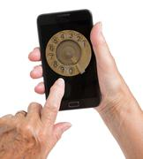 Senior woman hand with smart phone isolated, old fashion dial Stock Photos