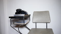 Vintage antique telephone table chair from the 1970s Stock Footage