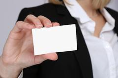 Stock Photo of Empty blank business card template hand contact people concept with copyspace
