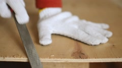 Locked Down Close up - Man Filing Sawdust from Pressed Wooden Board - stock footage