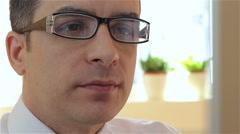 Businessman having a conversation via webcam - stock footage